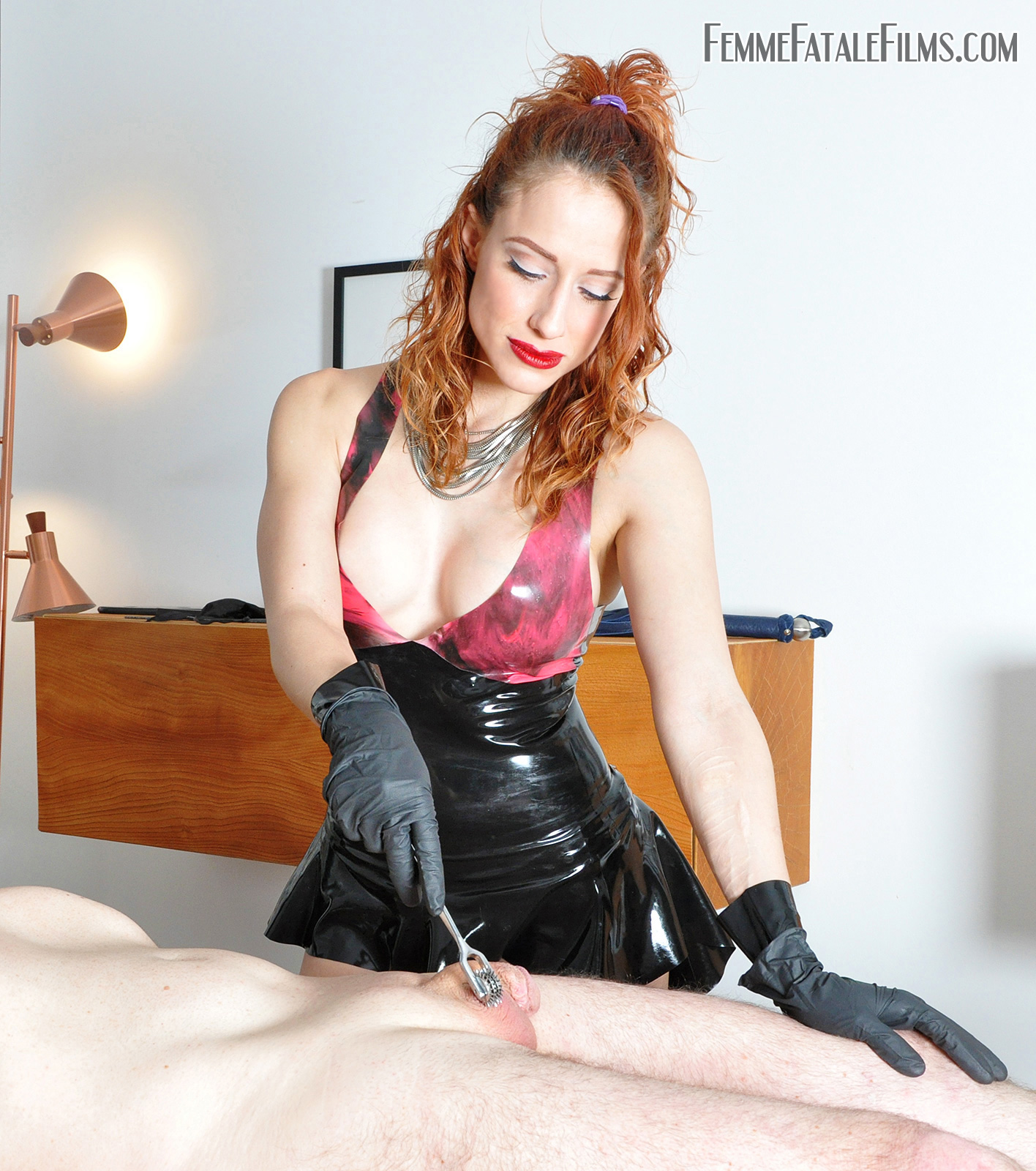 she plugs the slave's arse with a butt plug and to add to his humiliation then she fucks him hard while torturing his cock and balls with CBT