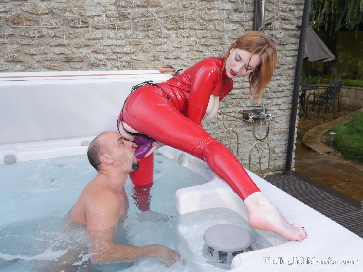 Zara du Rose toys with her slave in the English Mansion's spa, making him to suck her big black strapon before pegging his worthless arse