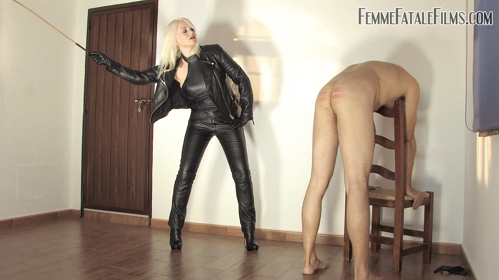 Goddess Heather Divine severely canes her slave