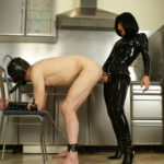 Pale-skinned submissive man slave takes massive strap-on from the backdoor