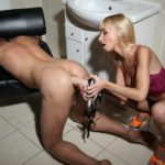 Seductive busty blonde fucking brawny guy with strapon at the toilet