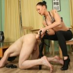 Mistress fucking the slave with one of the biggest strapons in her collection