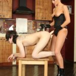 Slave shows his oral skills before taking his domina's strapon from the backdoor