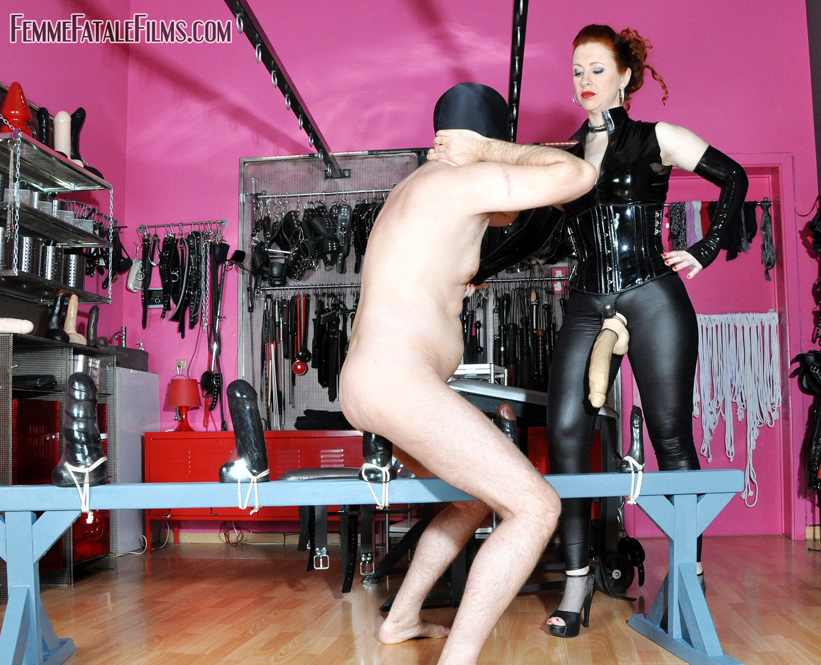Mistress Lady Renee then sets about stretching his ass further with her mammoth sized strap-on cock.