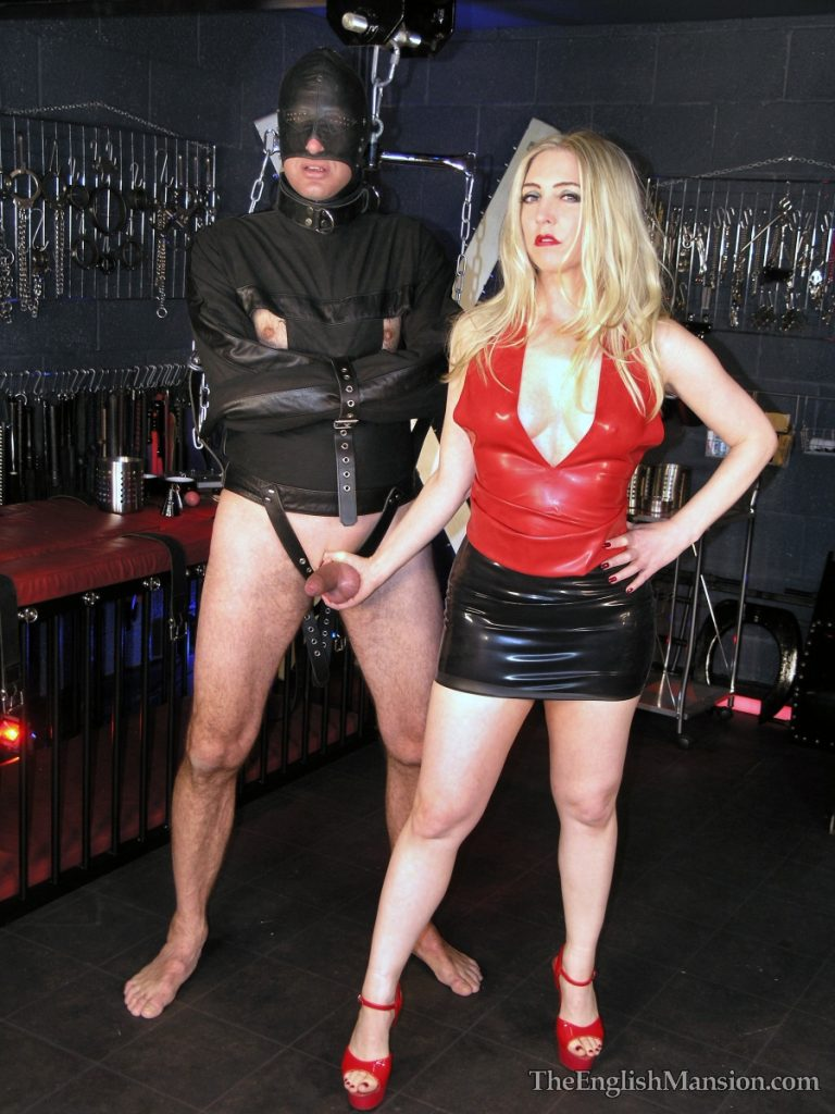 Mistress Sidonia tortures a slave's cock and balls