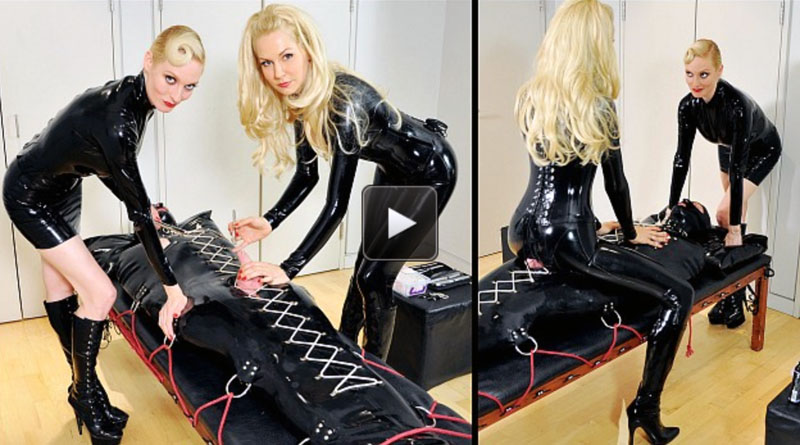 Featuring Lady Lola, Mistress Eleise de Lacy. The latex slave is fully enclosed in a body bag, and whilst strapped down tightly to the bondage table has his vulnerable parts exposed for the two Mistresses' amusement.