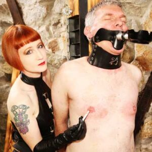 Mistress burns her slave's nipples with her cigarette