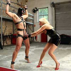 Blonde milf torments her slave by pulling on his cock and balls