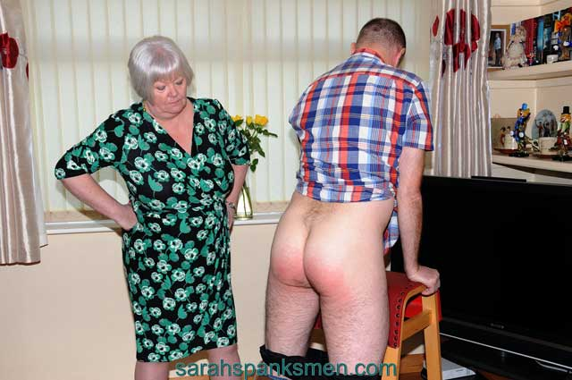Aunty Katie is back and looking for naughty men to spank and paddle. Her first victim just had to be the luckless Kodders, he just could not hold back and wanted to be the first to get bent over for a spanking from this lovely strict Aunty. She gave him just what he needed and he is now waiting on the next part of his punishment.